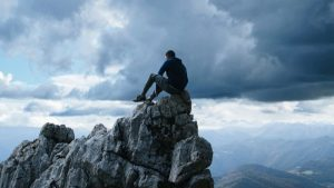 a man sitting on a mountain